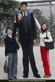tall_man_with_women